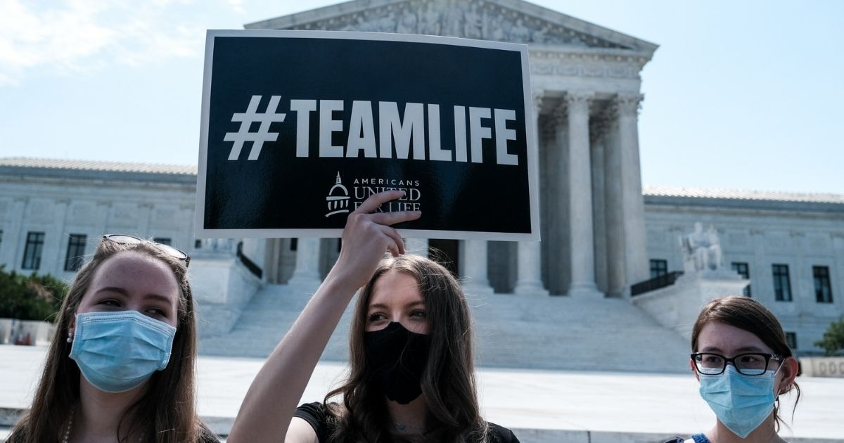 Pro-life activists stage a protest in front of the U.S. Supreme Court June 25, 2020, in Washington, D.C.
