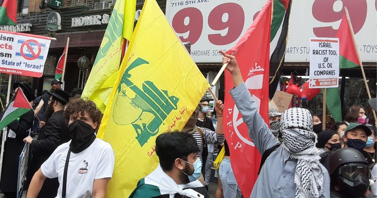 Pro-Palestine demonstrators carry the flags of terrorist organizations during a protest in New York on Aug. 7, 2020.