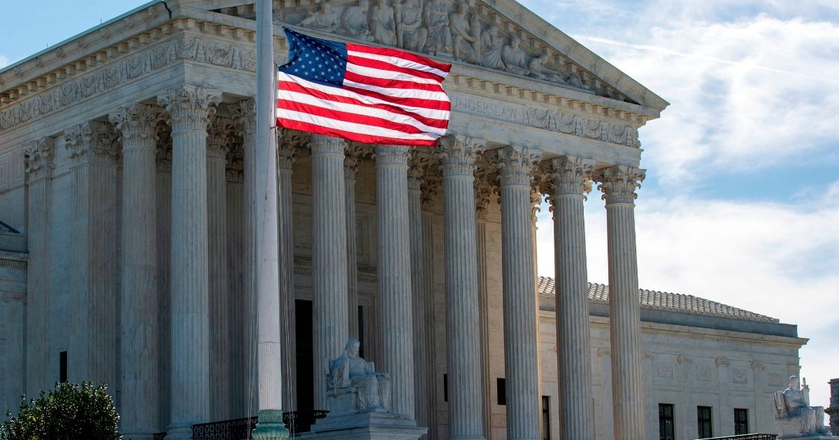 The American flag flies at half-staff outside of the US Supreme Court in memory of Justice Ruth Bader Ginsburg in Washington, D.C., on Sept. 19, 2020.