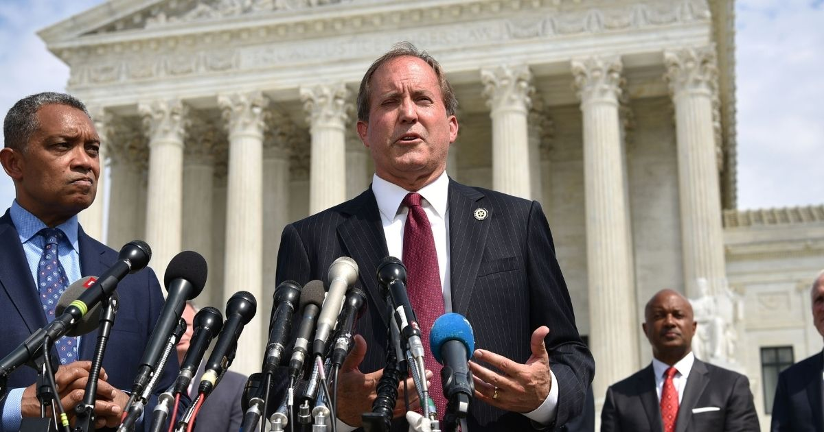 District of Columbia Attorney General Karl Racine, left, and Texas Attorney General Ken Paxton speak outside of the US Supreme Court in Washington, D.C., on Sept. 9, 2019.