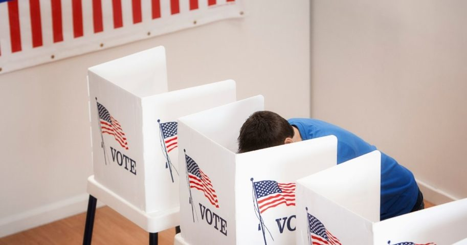 A man casts his vote in this stock image.