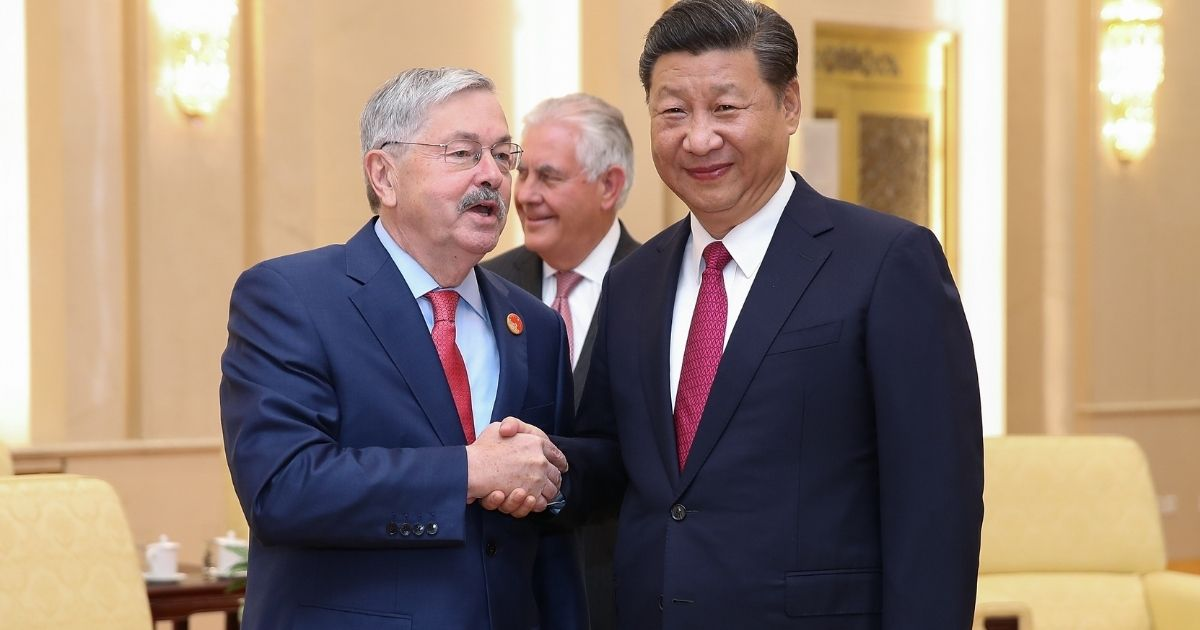 US Ambassador Terry Edward Branstad shakes hands with Chinese President Xi Jinping at the Great Hall of the People in Beijing on Sept. 30, 2017.