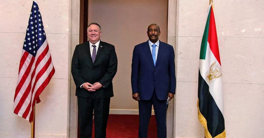 In this Aug. 25, 2020 file photo, US Secretary of State Mike Pompeo stands with Sudanese Gen. Abdel-Fattah Burhan in Khartoum, Sudan.