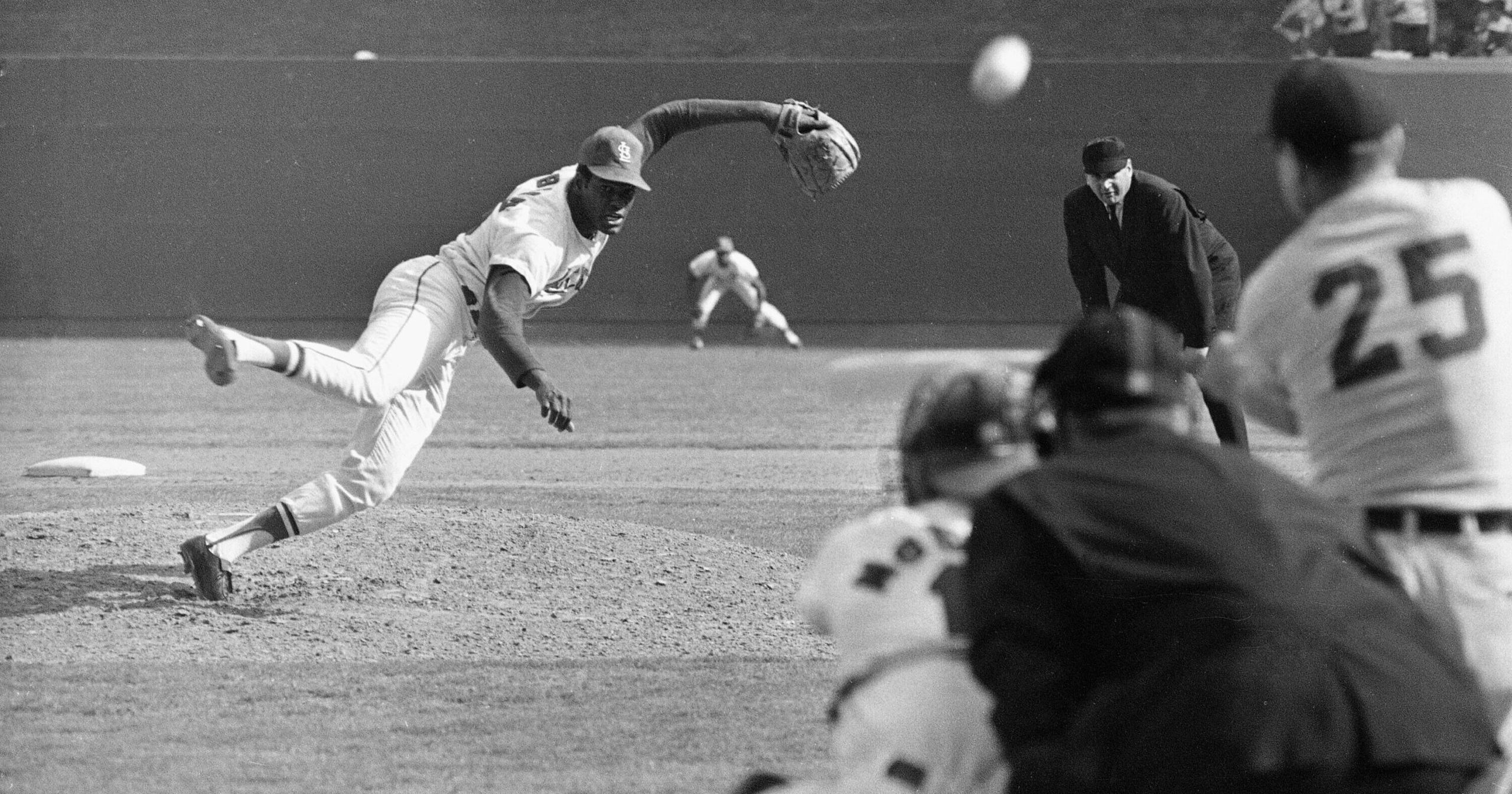 In this Oct. 2, 1968, file photo, St. Louis Cardinals pitcher Bob Gibson throws to Detroit Tigers' Norm Cash during the ninth inning of Game 1 of the World Series at Busch Stadium in St. Louis. Gibson died on Oct. 2, 2020. He was 84.