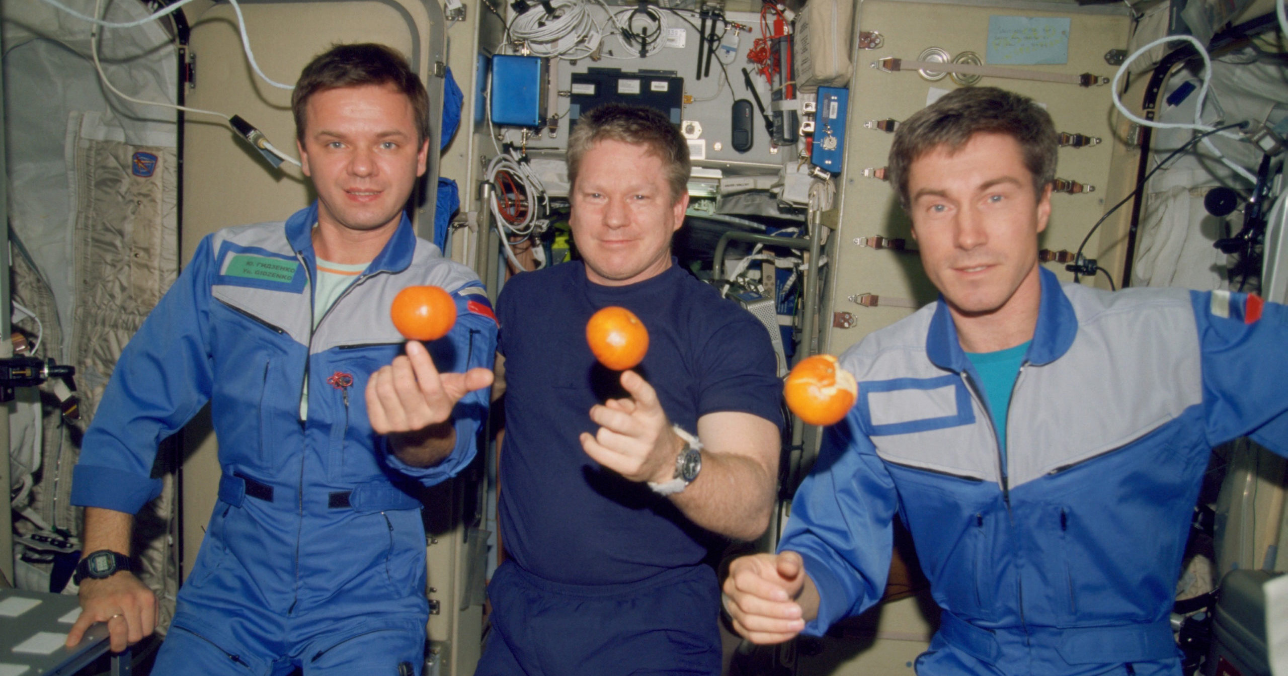 In this photo provided by NASA, Yuri Gidzenko, Bill Shepherd and Sergei Krikalev pose on board the International Space Station on Dec. 4, 2000.