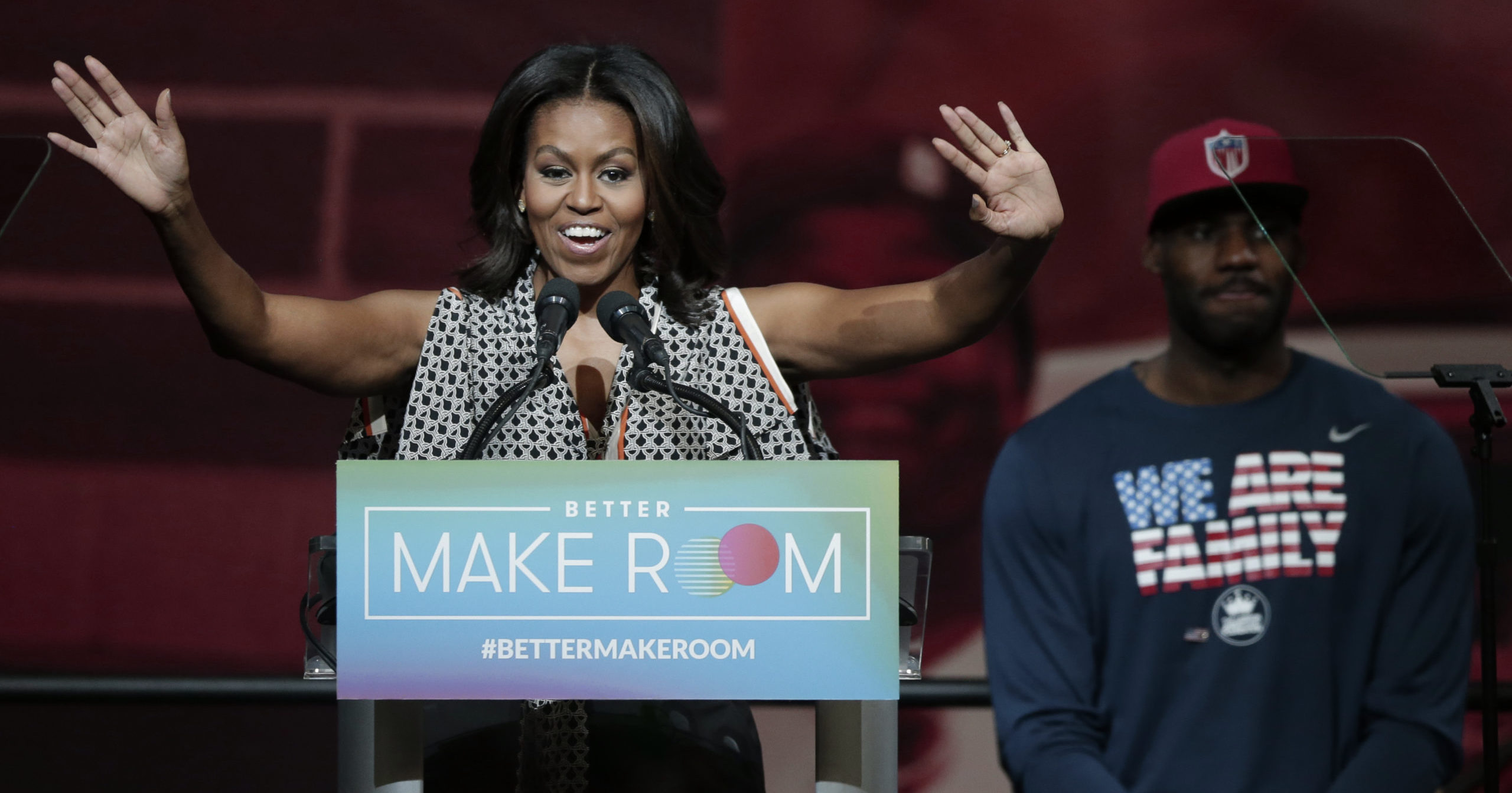 Then-first lady Michelle Obama speaks while NBA star LeBron James listens at the University of Akron in Ohio on Oct. 21, 2015.