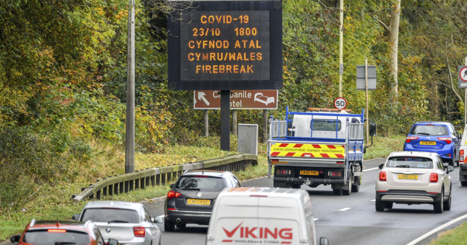A sign is seen on a road into Wales on Oct. 23, 2020.