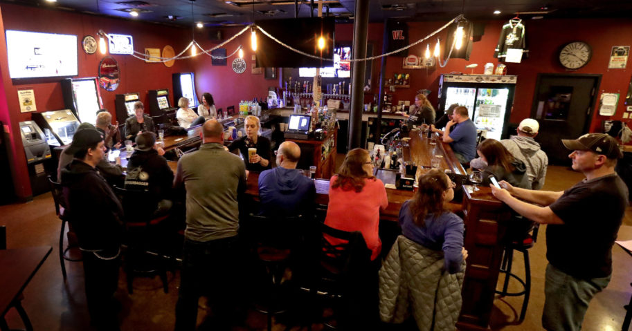 In this May 13, 2020, file photo, a pub opens to patrons in Appleton, Wisconsin. A Wisconsin judge on Oct. 14 temporarily blocked an order from Gov. Tony Evers' administration limiting the number of people who can gather in bars, restaurants and other indoor places.