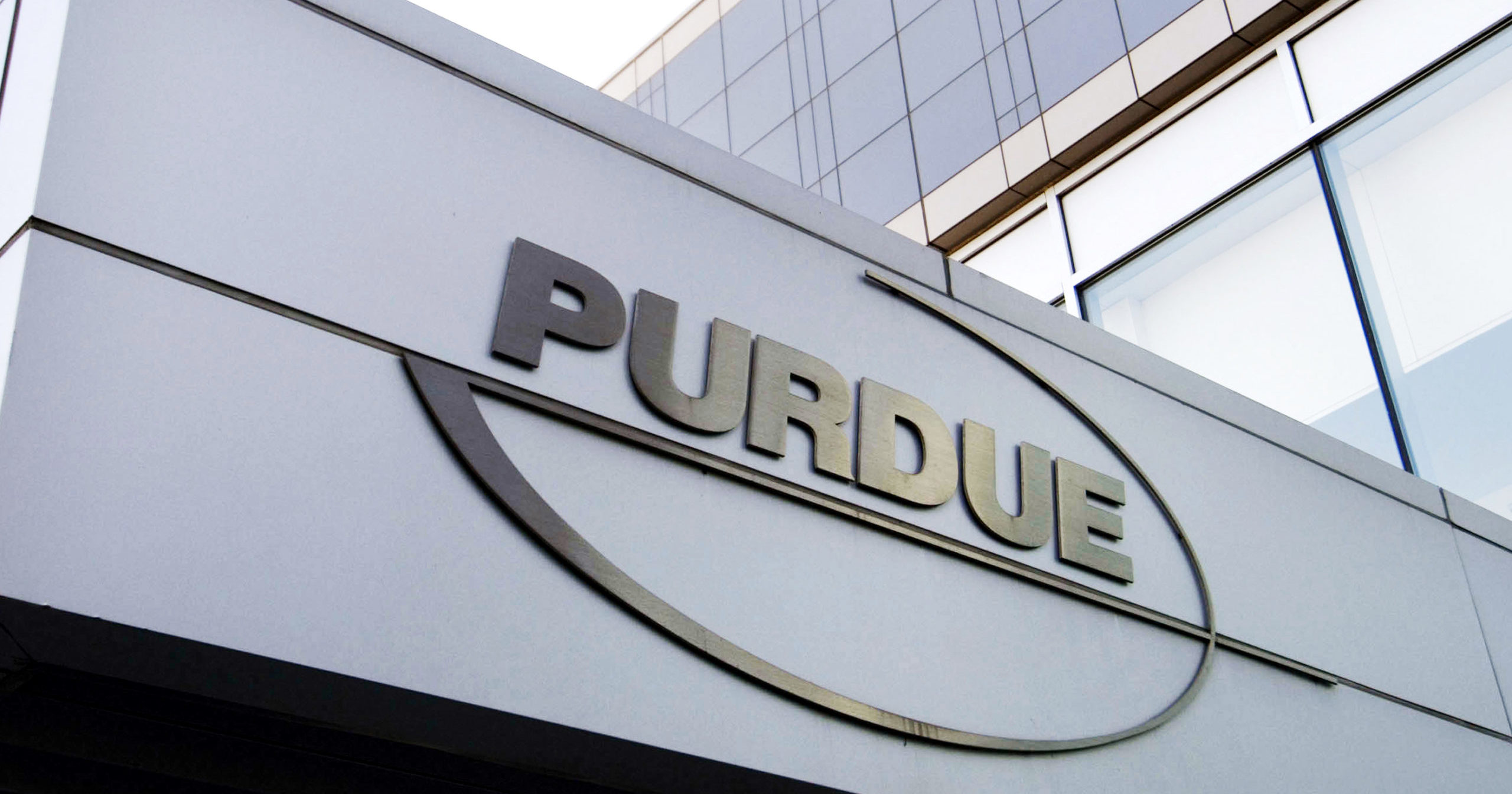 This May 8, 2007, file photo shows the Purdue Pharma logo at its offices in Stamford, Connecticut. Purdue Pharma, the company that makes OxyContin, the powerful prescription painkiller that experts say helped touch off an opioid epidemic, will plead guilty to three federal criminal charges as part of a settlement of over $8 billion, Justice Department officials told The Associated Press.