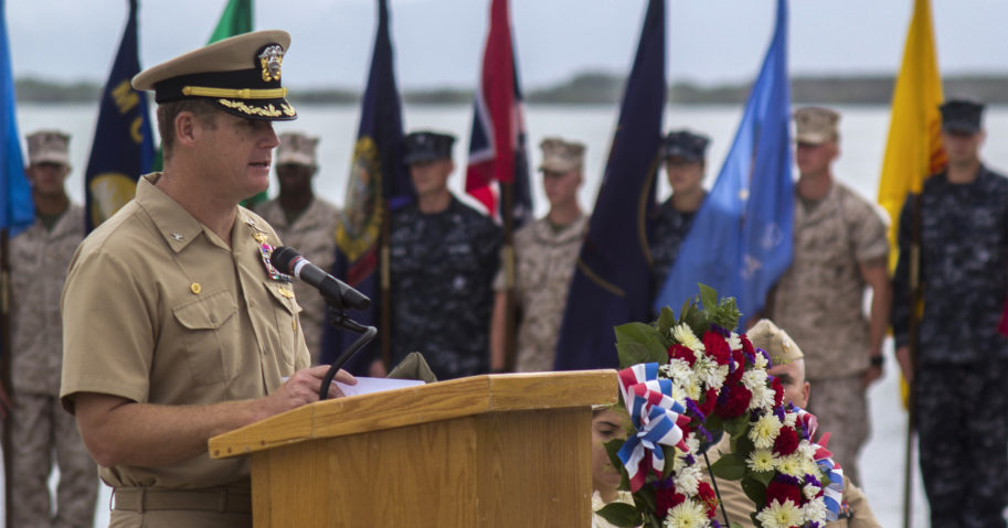 In this June 3, 2014, image provided by the US Navy, Capt. John R. Nettleton, then-commanding officer of Naval Station Guantanamo Bay, Cuba, speaks during a Battle of Midway commemoration ceremony.