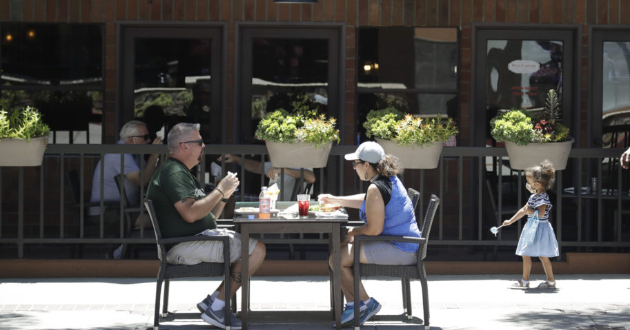 Patrons eat at a restaurant table set up on a sidewalk in Burbank, California, on July 18.