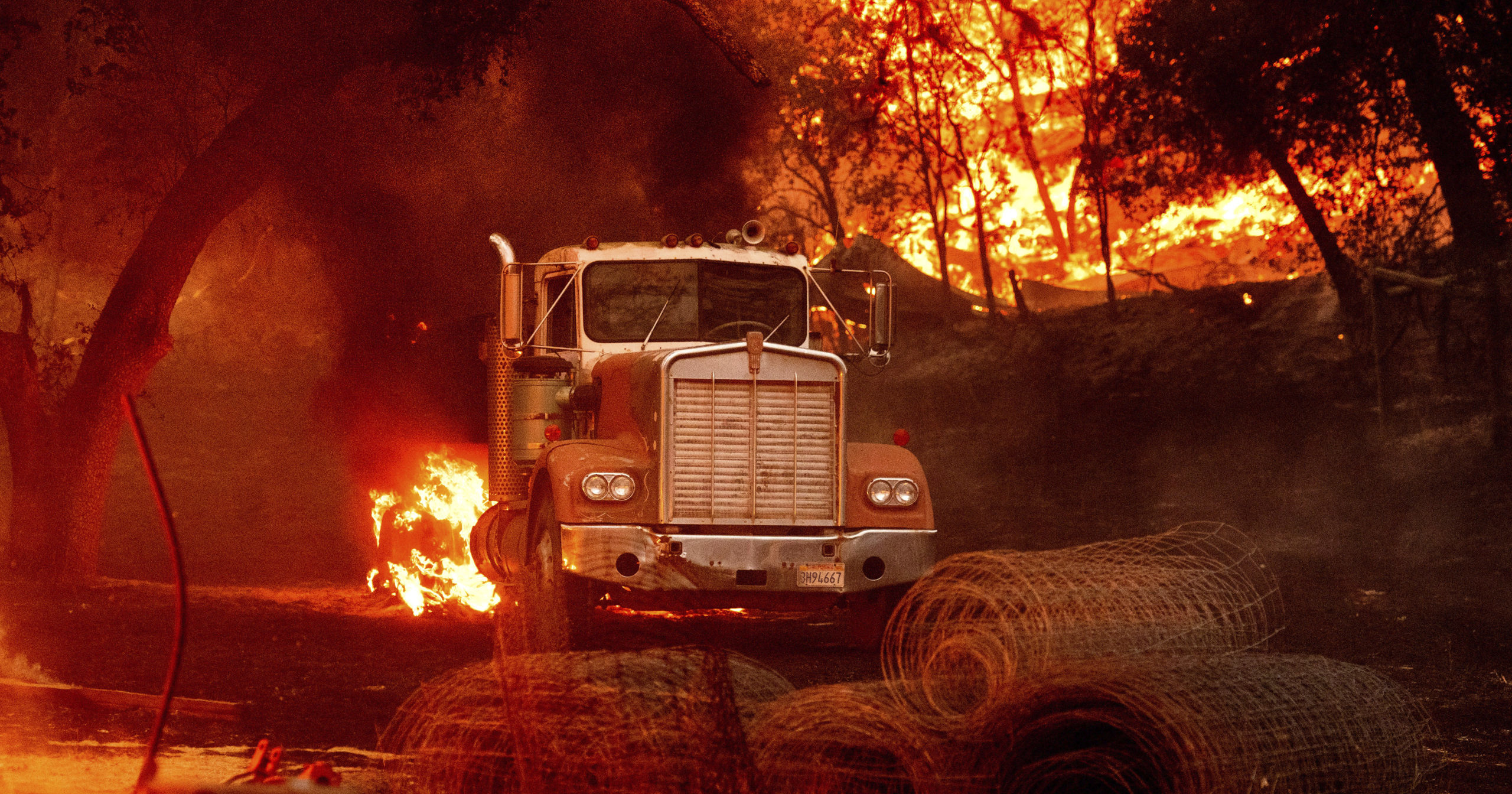 A truck burns in a Calistoga, California, vineyard on Oct. 1, 2020.