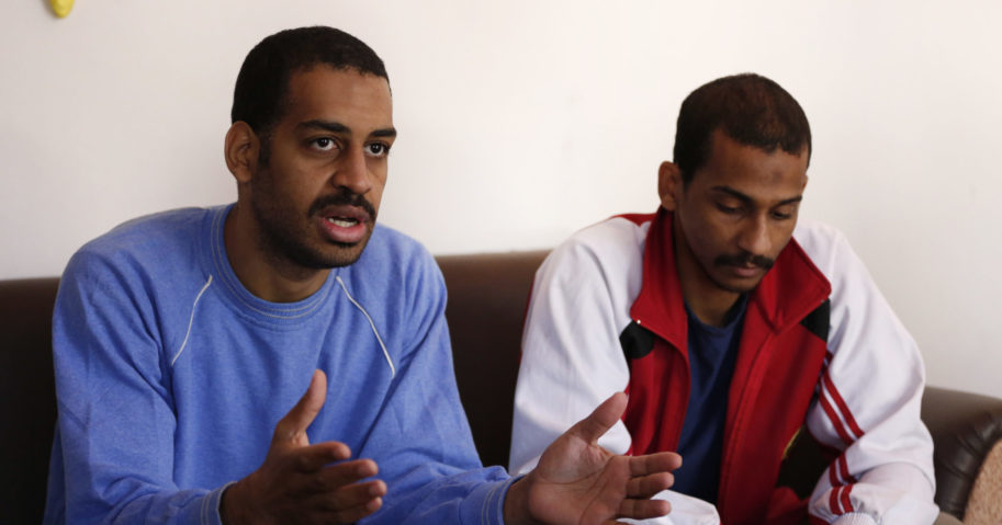 In this March 30, 2019, file photo, Alexanda Amon Kotey, left, and El Shafee Elsheikh speak during an interview with The Associated Press at a security center in Kobani, Syria.