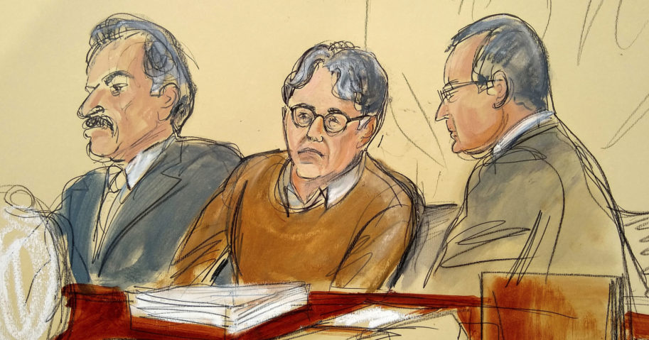 In this May 7, 2019, file courtroom drawing, defendant Keith Raniere, leader of the secretive group NXIVM, is seated between his attorneys during the first day of his sex trafficking trial.