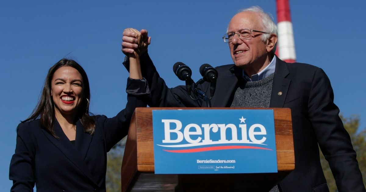 Democratic Rep. Alexandria Ocasio-Cortez of New York endorses independent Sen. Bernie Sanders of Vermont for president at a campaign rally in Queensbridge Park on Oct. 19, 2019, in the Queens borough of New York City.