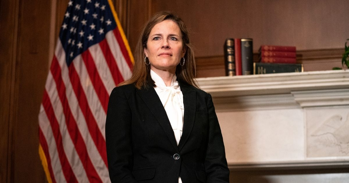 Judge Amy Coney Barrett, President Donald Trump's nominee for the Supreme Court, poses for a photo before a meeting with Montana Republican Sen. Steve Daines at the United States Capitol Building on Oct. 1, 2020, in Washington, D.C.