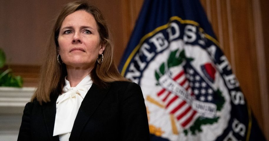 Judge Amy Coney Barrett, President Donald Trump's nominee to the Supreme Court, meets with Iowa GOP Sen. Joni Ernst (not seen) at the U.S. Capitol on Thursday in Washington, D.C.