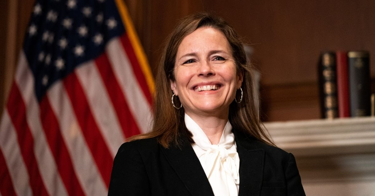 Judge Amy Coney Barrett, President Donald Trump's nominee for Supreme Court, poses for a photo before a meeting with Republican Sen. Steve Daines of Montana at the United States Capitol in Washington, D.C., on Thursday.