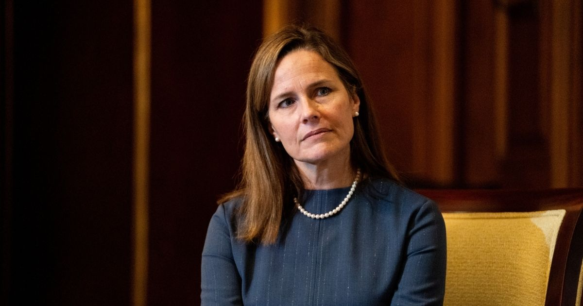 Judge Amy Coney Barrett, President Donald Trump's nominee for the U.S. Supreme Court, meets with Republican Sen. Rick Scott of Florida as she begins a series of meetings to prepare for her confirmation hearing at the U.S. Capitol in Washington, D.C., on Tuesday.
