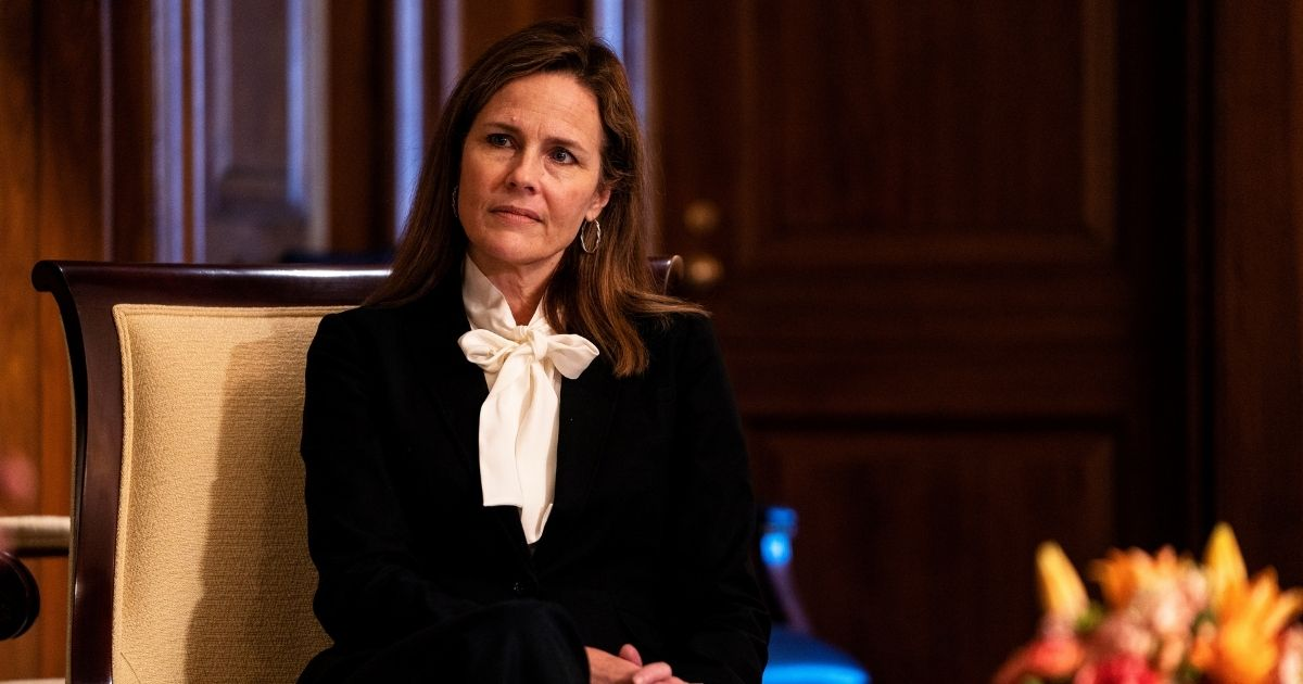 Judge Amy Coney Barrett, President Donald Trump's nominee to the Supreme Court, meets with Missouri GOP Sen. Josh Hawley (not pictured) during a photo op at the U.S. Capitol on Thursday in Washington, D.C.