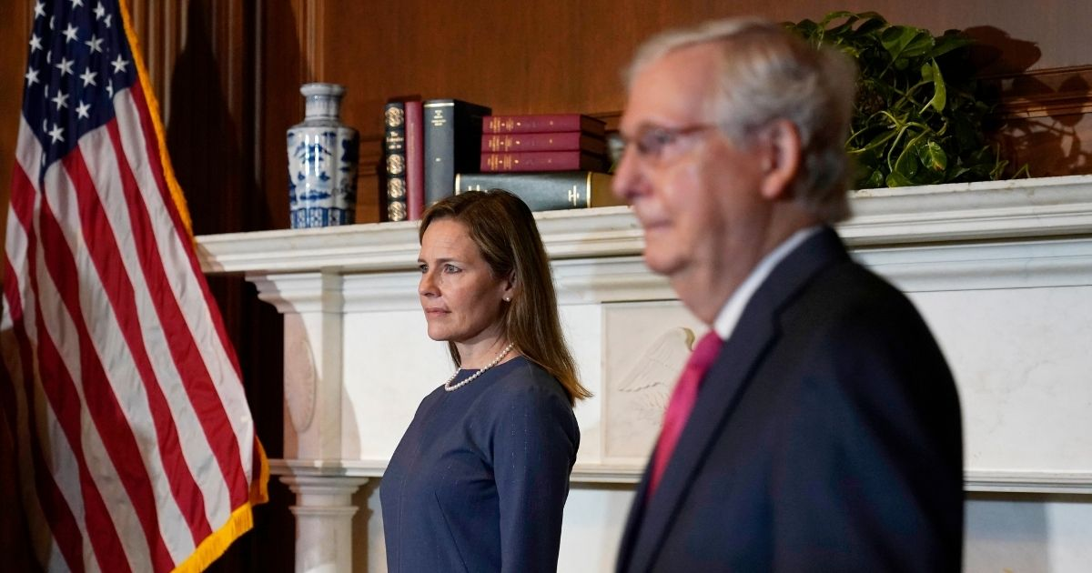 Seventh U.S. Circuit Court Judge Amy Coney Barrett, left, President Donald Trump's nominee for the Supreme Court, meets with Senate Majority Leader Mitch McConnell on Capitol Hill on Tuesday in Washington, D.C.