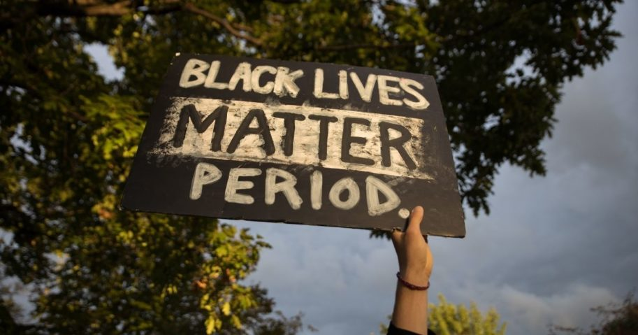 "A protester holds a ""Black Lives Matter"" sign outside the debate center during the first presidential debate at Case Western Reserve University in Cleveland on Tuesday."