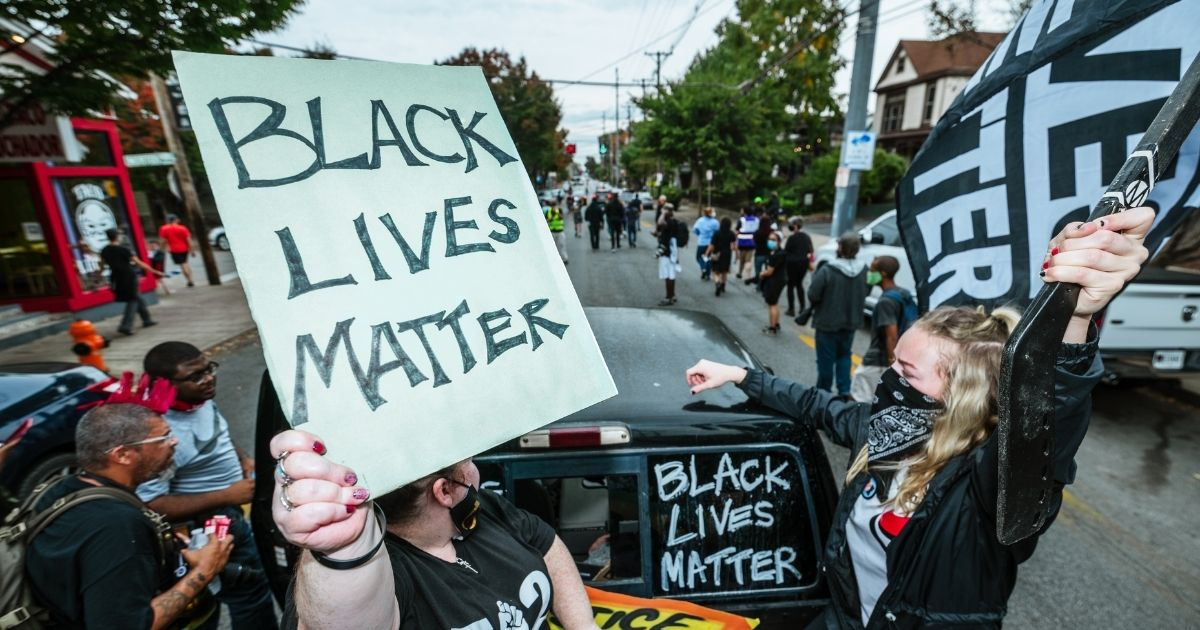 A group of protesters gather in the street during a march to the Breonna Taylor memorial at Jefferson Square Park on Oct. 10, 2020, in Louisville, Kentucky.