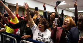 "Supporters of President Donald Trump cheer as he arrives to speak during the launch of ""Black Voices for Trump"" at the Georgia World Congress Center on Nov. 8, 2019, in Atlanta."