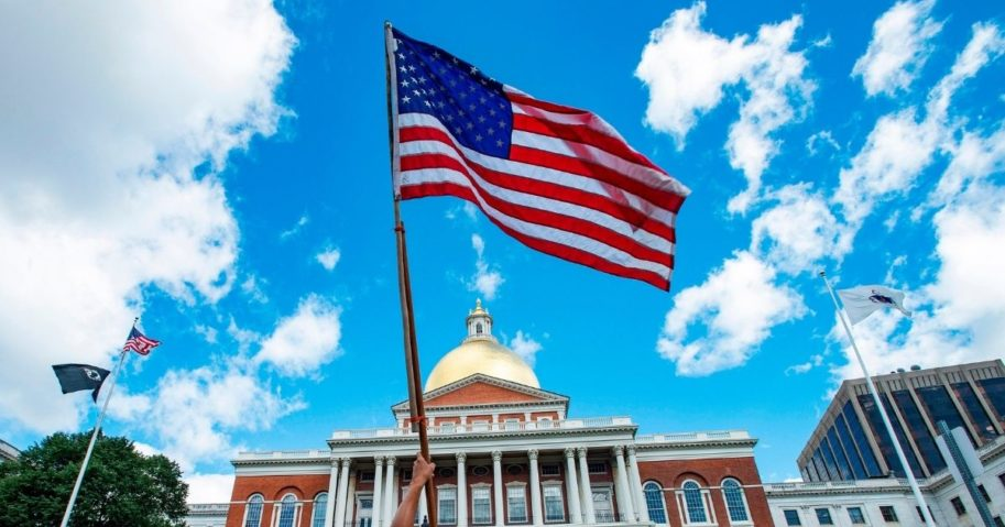 An American flag is seen during a protest outside the Massachusetts State House in Boston on Aug. 30, 2020.