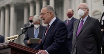 Senate Minority Leader Chuck Schumer of New York and Democratic members of the Senate Judiciary Committee hold a news conference after boycotting the vote by the Republican-led panel to advance the nomination of Judge Amy Coney Barrett to sit on the Supreme Court on Thursday in Washington.