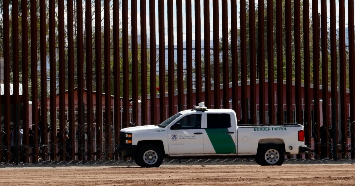 A Customs and Border Protection vehicle sits near the wall as President Donald Trump visits a new section of the border wall with Mexico in El Centro, California, on April 5, 2019.