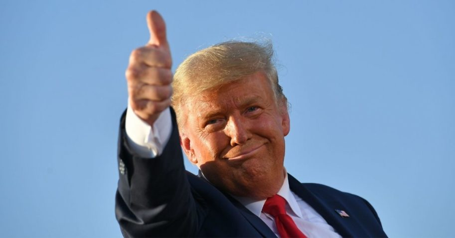 President Donald Trump gives a thumbs up as he leaves a rally at the Tucson International Airport in Arizona on Oct. 19.