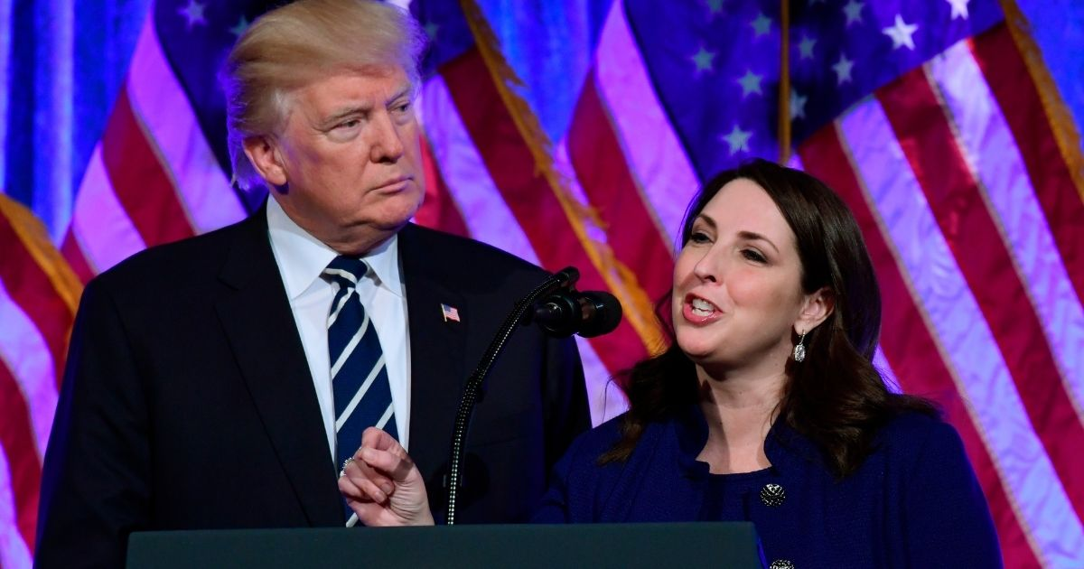 In this Dec. 2, 2017, photo, Republican National Committee Chairwoman Ronna McDaniel, right, speaks at a fundraiser in New York with President Donald Trump.