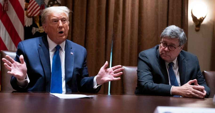 Attorney General William Barr, right, listens as President Donald Trump speaks during a meeting with Republican state attorneys general about social media companies in the Cabinet Room of the White House on Sept. 23, 2020, in Washington