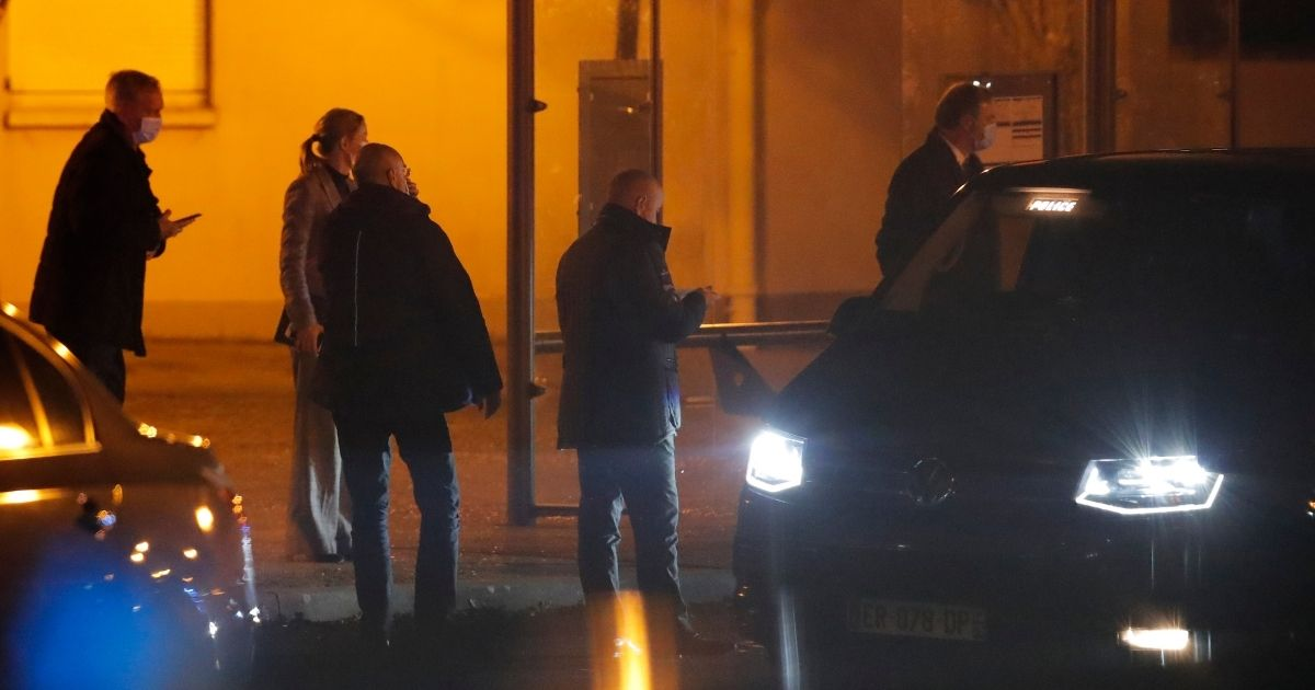 French police officers gather outside a high school in Conflans-Saint-Honorine, north of Paris, after a history teacher who opened a discussion with students on caricatures of Islam's Prophet Muhammad was beheaded Friday.