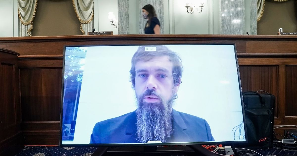 Twitter CEO Jack Dorsey gives his opening statement remotely during a Senate hearing Wednesday in Washington.