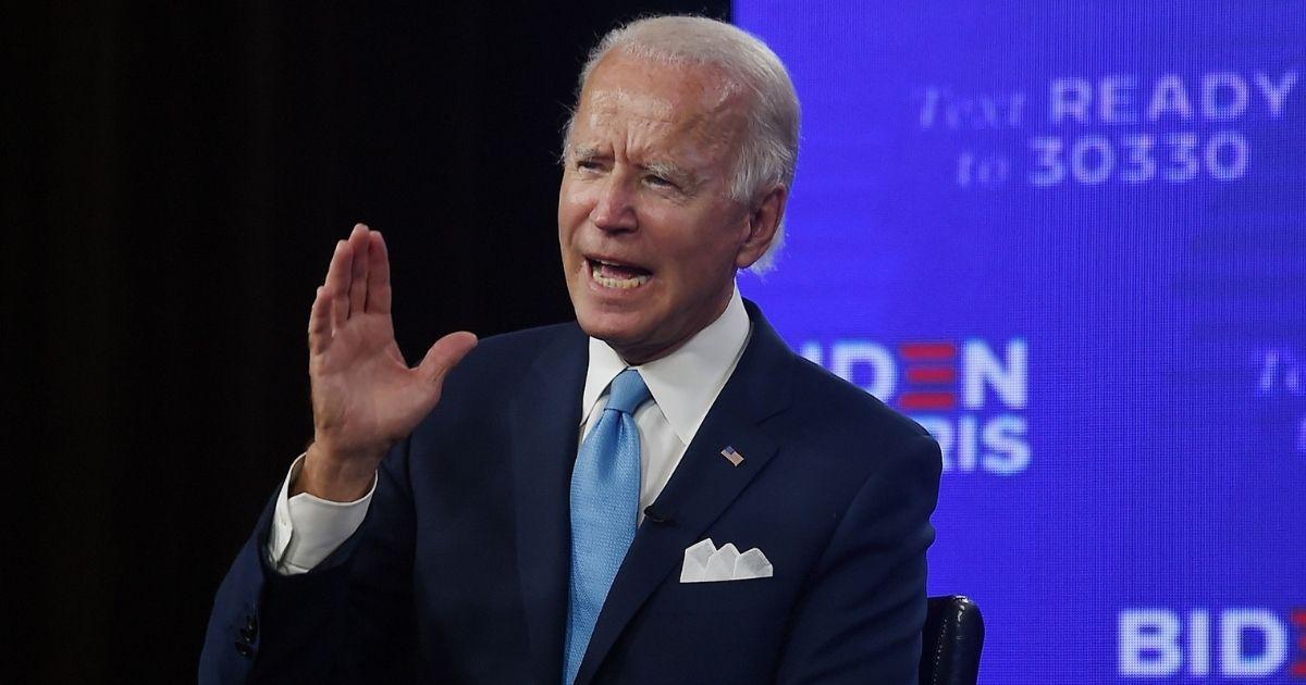 Democratic presidential nominee Joe Biden speaks during a virtual grassroots fundraiser alongside his vice presidential running mate, California Sen. Kamala Harris, at the Hotel du Pont in Wilmington, Delaware, on Aug. 12, 2020.