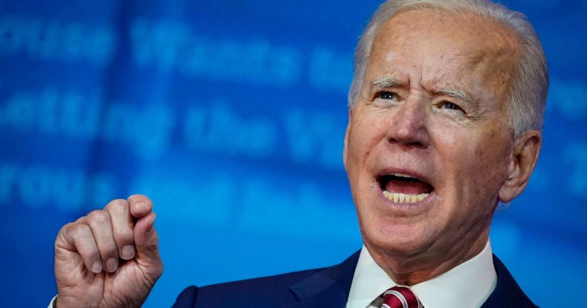 Democratic presidential nominee Joe Biden speaks about his plans for combatting the coronavirus pandemic at The Queen theater in Wilmington, Delaware, on Friday.