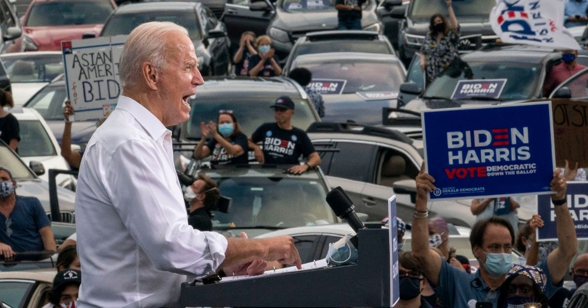 Democratic presidential nominee Joe Biden speaks during a drive-in campaign rally in the parking lot of Cellairis Ampitheatre in Atlanta on Tuesday.