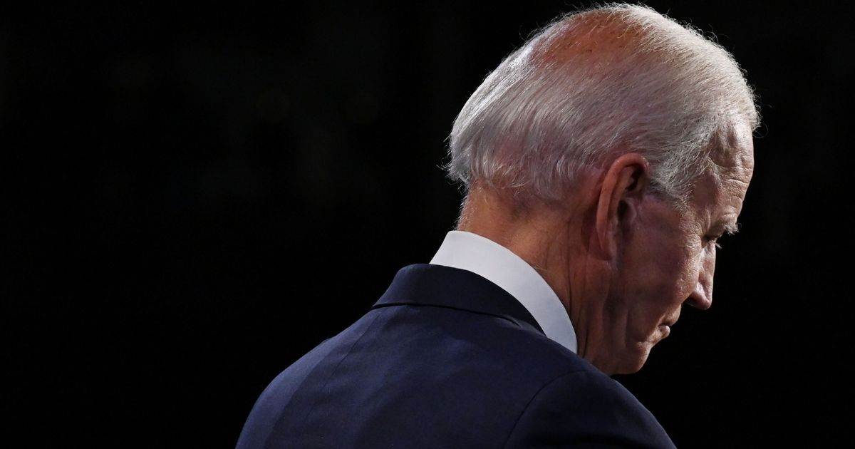 Democratic presidential nominee Joe Biden listens as he debates President Donald Trump at Case Western Reserve University and Cleveland Clinic on Tuesday in Cleveland, Ohio.