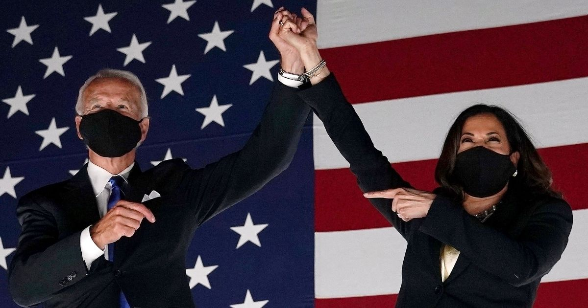 Democratic presidential nominee Joe Biden and his running mate, California Sen. Kamala Harris, greet supporters outside the Chase Center in Wilmington, Delaware, at the conclusion of the Democratic National Convention on Aug. 20, 2020.