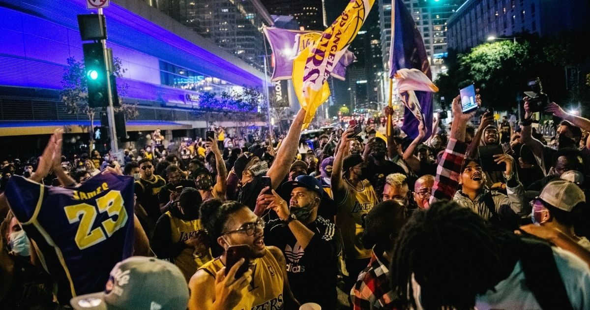 Fans celebrate in front of the Staples Center in Los Angeles on Oct. 11, 2020, after the Lakers defeated the Miami Heat in Game 6 of the NBA Finals.
