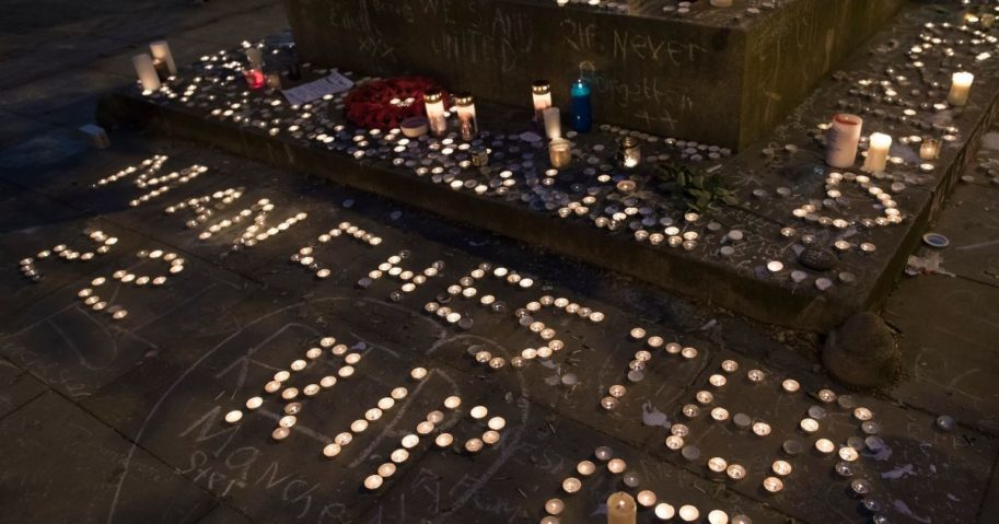 Memorial candles are seen during a vigil on St Ann's Square in Manchester, northwest England, on May 29, 2017, exactly one week after a bomb attack at Manchester Arena killed 22 and injured hundreds more.