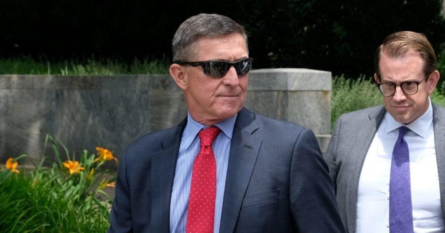 Former National Security Advisor Michael Flynn, left, leaves the E. Barrett Prettyman U.S. Courthouse on June 24, 2019, in Washington, D.C.