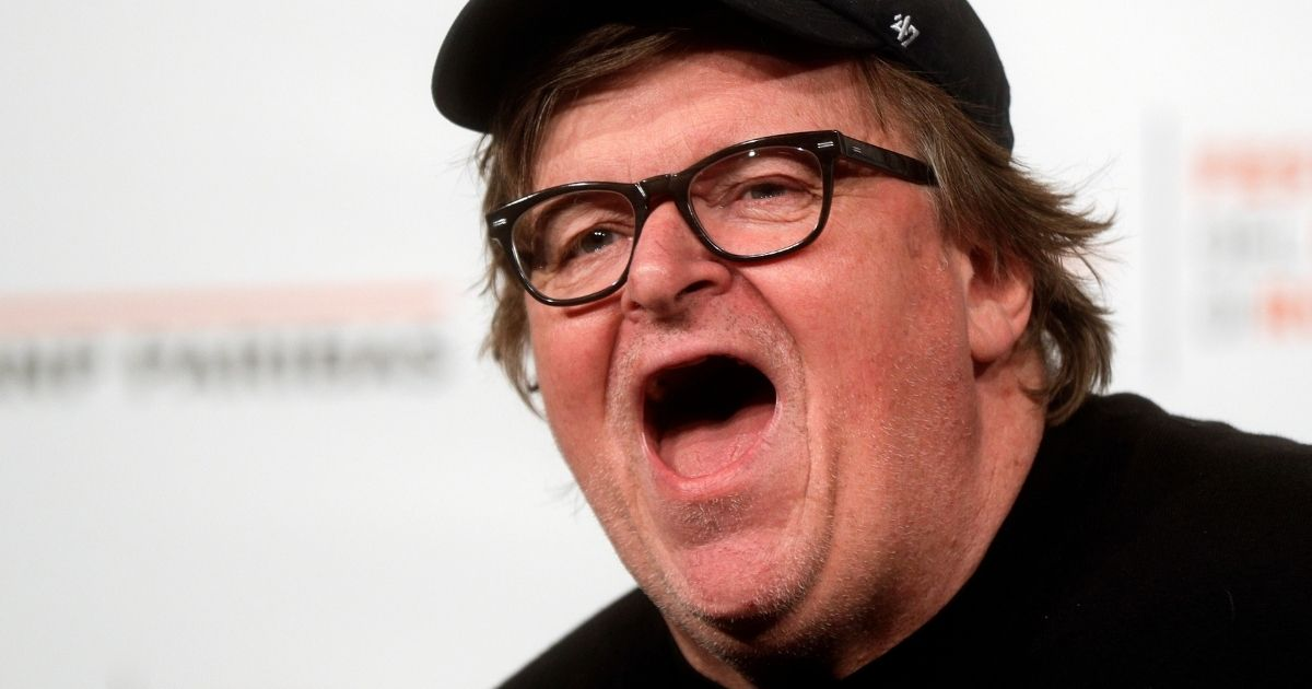 """Michael Moore poses for photographers during a photo call of the movie """"Fahrenheit 11/9"""" at the 13th edition of the Rome Film Fest in Rome on Oct. 20, 2018."""