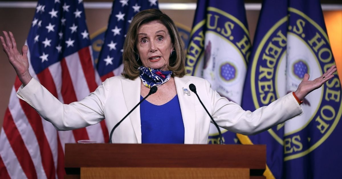 Speaker of the House Nancy Pelosi talks to reporters during her weekly news conference on Thursday in Washington.