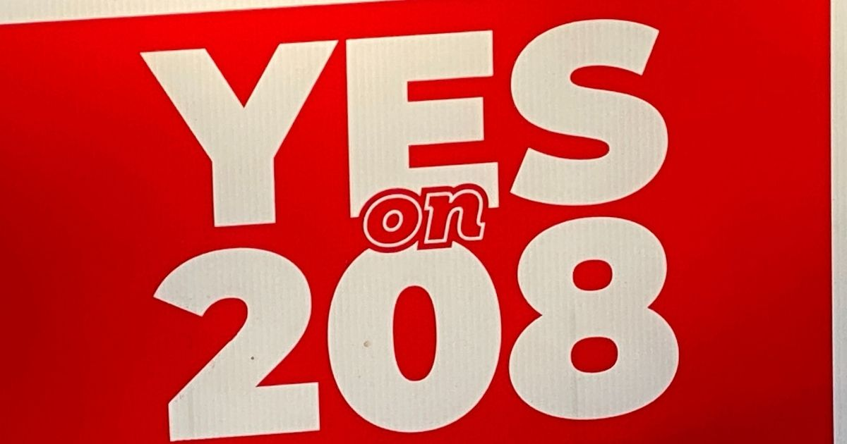 A yard sign promoting Proposition 208, a new Arizona tax initiative, is pictured above.