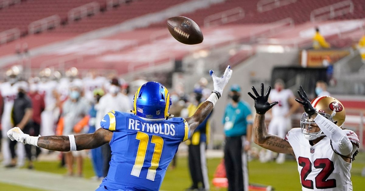Jason Verrett #22 of the San Francisco 49ers intercepts a pass intended for Josh Reynolds #11 of the Los Angeles Rams in the end zone during the third quarter at Levi's Stadium on Sunday in Santa Clara, California.