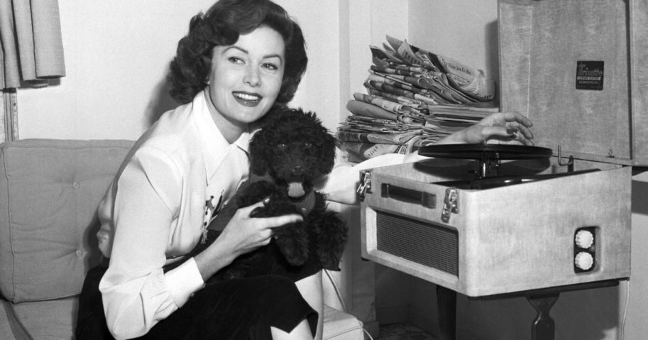 Actress Rhonda Fleming reads in her penthouse apartment in Rome on March 1, 1955.