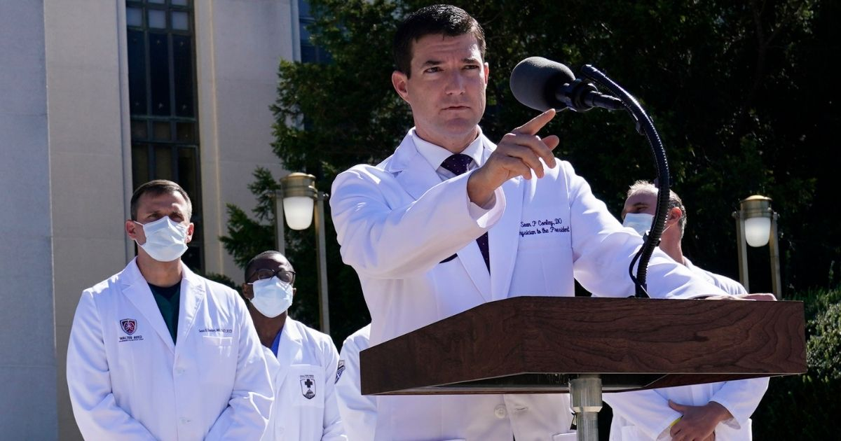 Dr. Sean Conley, physician to President Donald Trump, briefs reporters at Walter Reed National Military Medical Center in Bethesda, Maryland, on Saturday.